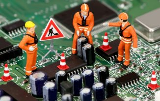 Miniature technicians working on a computer circuit board or motherboard. Tech support concept.